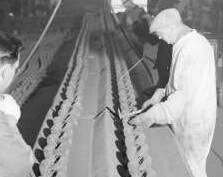 Links inspection at chain factory, 1943 (detail cut from public domain photo)
